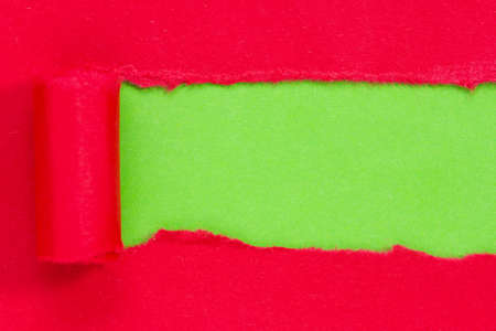 rips: Red paper torn to reveal green panel ideal for copy space Stock Photo