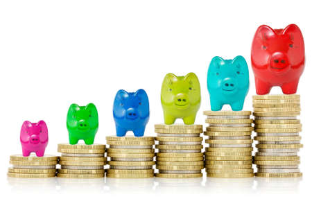 Piggy banks on top of stack of coins showing growth  photo