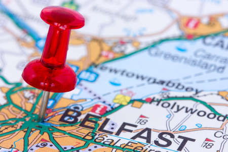 Red pushpin on the Northern Ireland map showing Belfast location photo