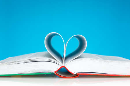 Selective focus image of book folded into a heart shape  photo