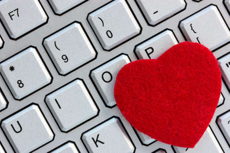 internet dating: Internet dating concept. Red heart on the computer keyboard.