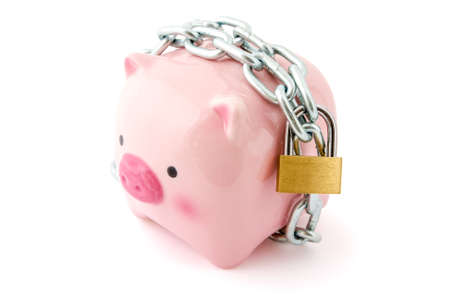 inferences: Piggybank chained up and locked. Concept for financial protection inferences or other investment messages.