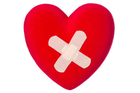 abandonment: Red heart with plaster, isolated on white background Stock Photo