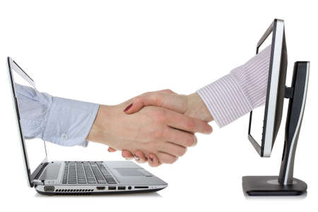 Two computers and hands in handshaking photo