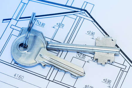Closeup of keys on blueprint of new home photo
