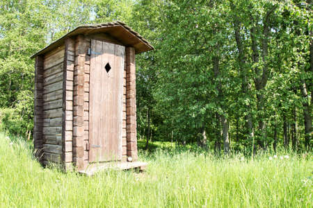 Old wooden outhouse for tourists at a forest  Stok Fotoğraf