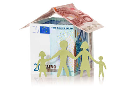Family and their Euro house made from banknotes on white background  photo