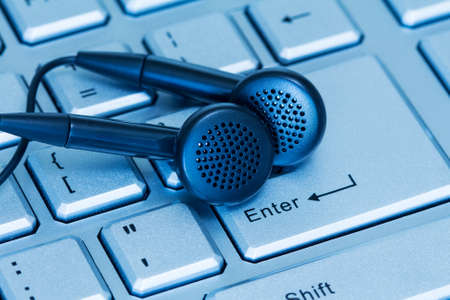 digital music: Headphones and computer keyboard, concept of digital music