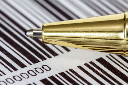 numerate: Close up view of pen on barcode background Stock Photo