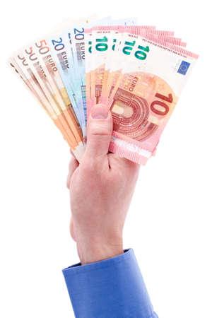 billets euro: Man main avec l'euro isolé sur fond blanc Banque d'images