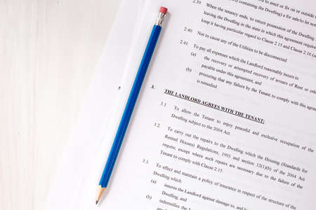 tenant: Pencil with agreement between landlord and tenant Stock Photo
