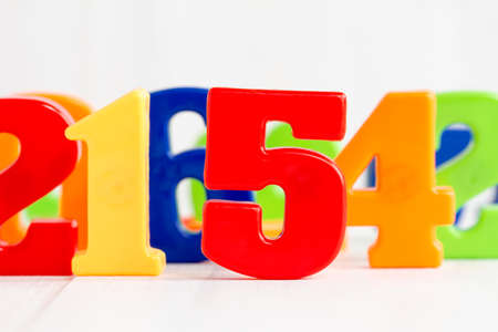 elementary schools: Playing with colored numbers over a white background
