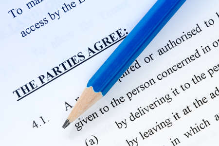 landlord: Pencil on the agreement between landlord and tenant