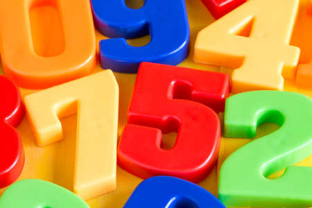 elementary schools: Colorful plastic numbers on a painted wooden background