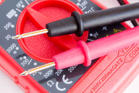 amperage: Closeup of digital multimeter  with two probes connected