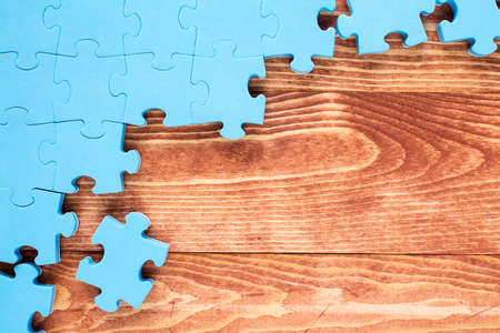 coalition: Puzzle on brown wooden background.Team business concept