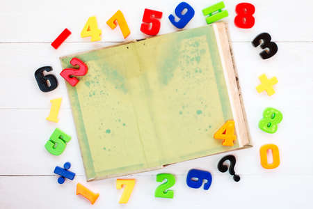copyspace: Colorful plastic numbers and open book with copy-space Stock Photo