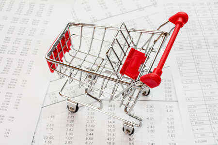 empty shopping cart: Empty shopping cart on a financial report Stock Photo