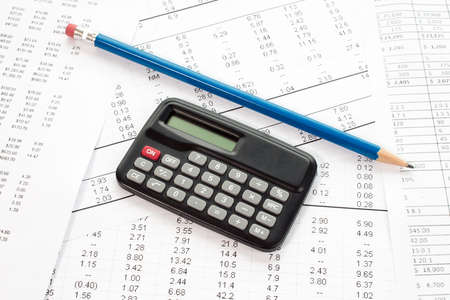 Accounting in process with calculator,pencil  and financial charts Stock Photo