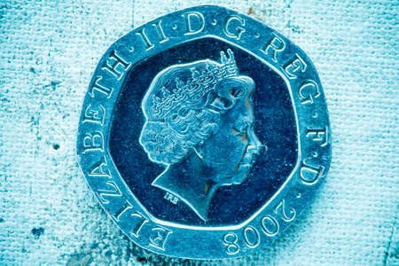 pence: Fifty pence on canvas background in blue tone