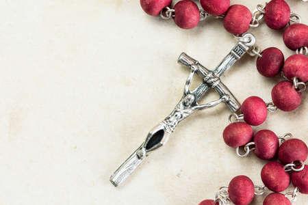 catholic symbol: Catholic rosary on old paper background with copy-space Stock Photo