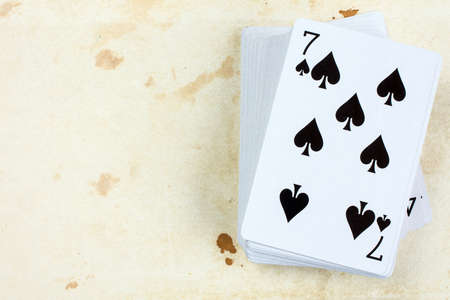 top seven: A poker card deck with seven of spades on the top Stock Photo