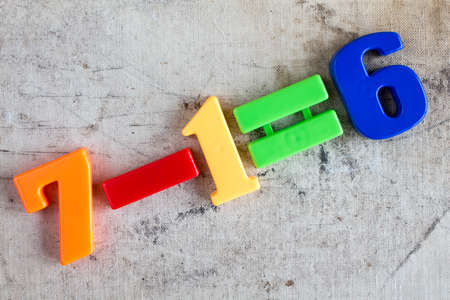 subtraction: Simple subtraction formula with colorful plastic numbers
