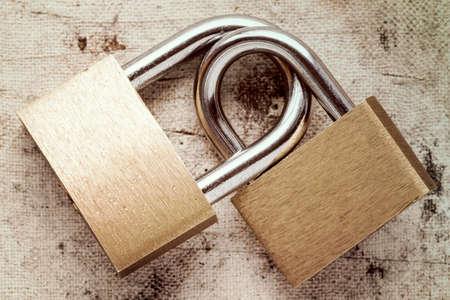 linked: Two linked padlocks symbolizing good relationships or marriage