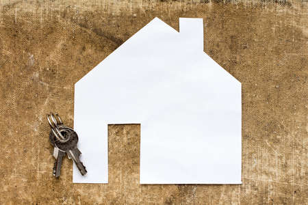 House icon and keys on dirty canvas background Stock Photo
