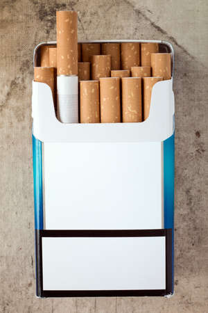 with pack: Pack of cigarettes with cigarettes sticking out. Copy space for your text. Stock Photo