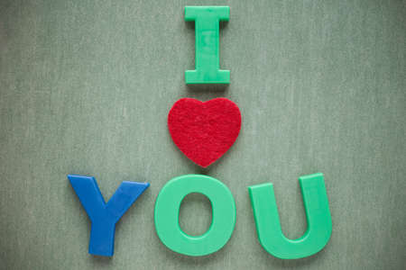 love card: I love you text on green paper background