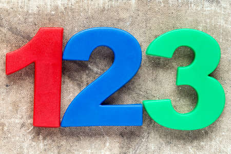 elementary schools: 123 colorful plastic number on the canvas background
