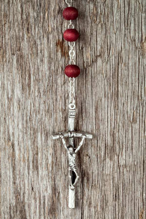 cross: Silver cross crucifix hanging on old wooden background