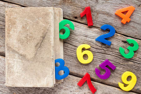 elementary schools: Color plastic numbers coming out from a old book