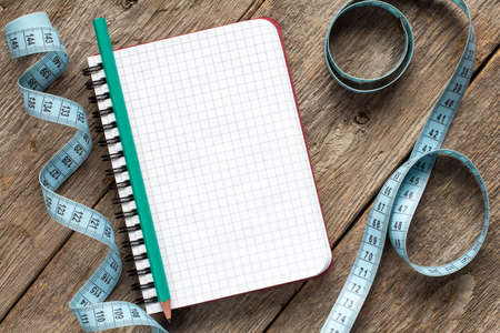 reforming: Measure tape,pencil and blank notebook for your resolutions