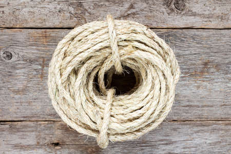 sisal: Roll of sisal rope on the old wooden surface