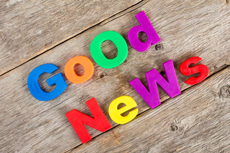 news letter: Colored  letter magnets spelling text GOOD NEWS