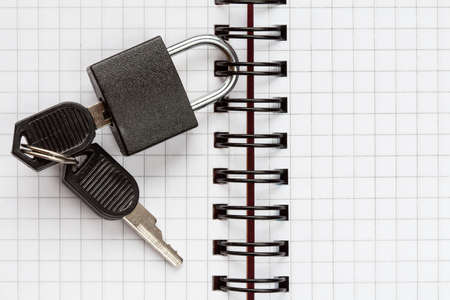 censor: Open notebook with a padlock and keys, text space
