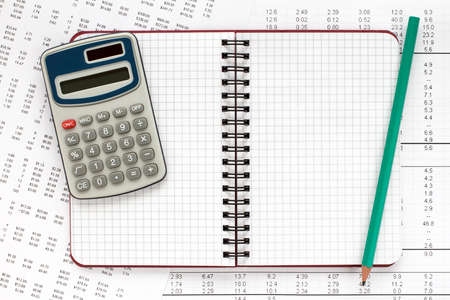 financial statement: Calculator and spiral notebook on financial statement , concept of accounts. Stock Photo