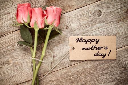 gratefulness: Mothers day card with roses on wooden board.