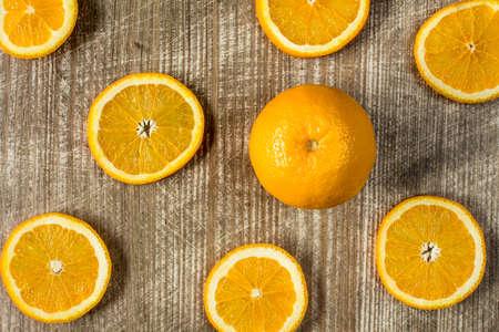 sliced orange: Whole orange fruit and sliced orange on wooden background Stock Photo