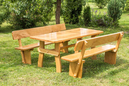 Wooden Set Of Table Benches With Backrests On Green Grass Lawn - Picnic table with backrest
