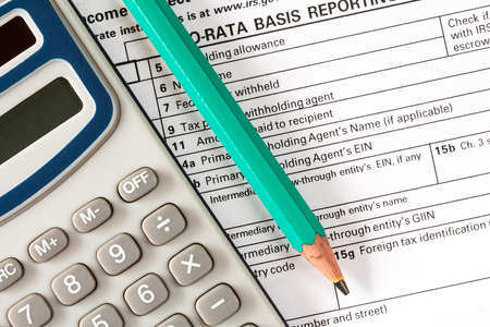 filling out: Filling out the form 1042-s which confirms the payment of the tax in the USA Stock Photo
