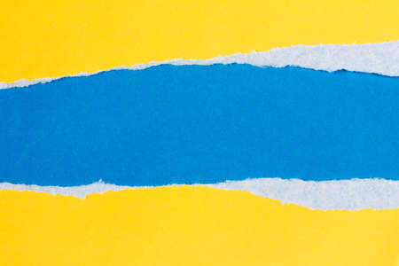 Torn yellow paper with a blue background for your text.