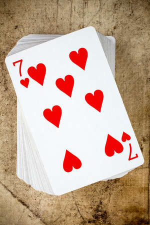 top seven: A poker card deck with seven of hearts on the top