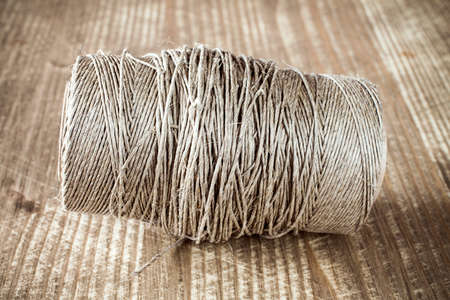 twine: Skein jute twine on old wooden table background