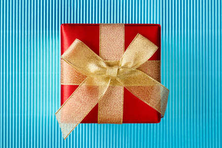 Gift box on blue corrugated paper background