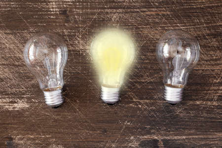 uniqueness: Lightbulb glowing among the others. Uniqueness concept.