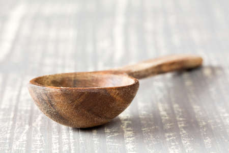 stirrer: Wooden spoon on the grey wooden table Stock Photo