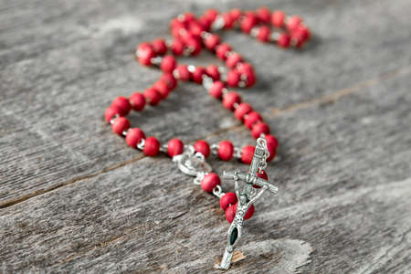 Close-up view of rosary on  wooden texture background